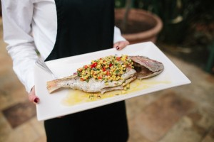 whole snapper grilled over charcoal, red pepper & corn salsa