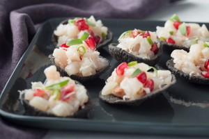 tunisian kingfish ceviche on squid ink crackers