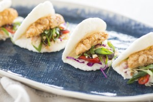 sichuan tofu bao, chilli-pickled vegetables, peanuts, spring onion
