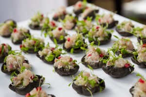 tunisian kingfish ceviche on squid ink crackers.  photo credit sarah wood photography