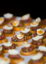 steak tartare crostini, soft boiled quail egg, truffled aioli