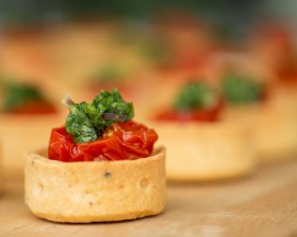 smoked goat's curd & semi-dried cherry tomato tartlets, salsa verde