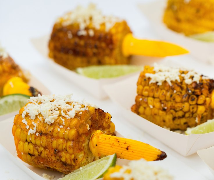 charred corn with lime wedges